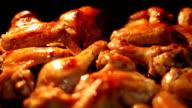 Chicken drummets deep frying in oil video