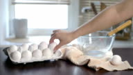 Chicken eggs on kitchen table. Cook preparing ingredients for food cooking video