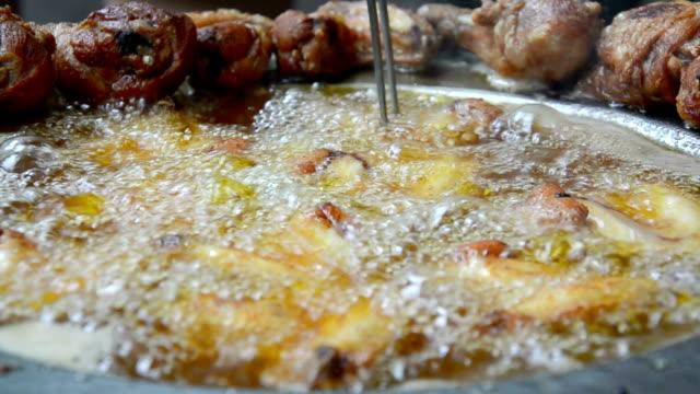 Chicken frying in oil video