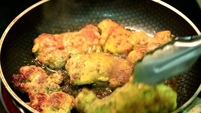 Chicken frying in pot video