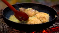 Chicken Legs are Frying on a Fire video