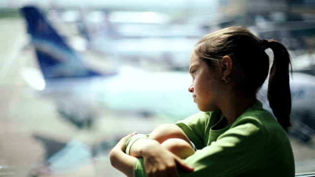 Child at the airport waiting for time of flight video