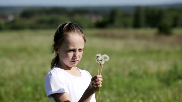 Child blowing dandelion video