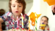 Child Blowing Out Candles on a Birthday Cake HD 1080p video