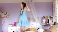 Child bouncing on her bed video