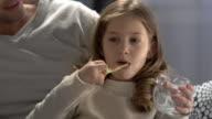 Child brushing her teeth before bedtime video