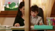 Child, busy woman, businesswoman, son, multi-tasking mom working at home video