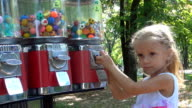 Child Buying Ball Toy from Vending Machine, Playing Little Girl video