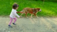 Child Children Little Girl Running With Animal Dog Pet Outdoors video