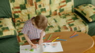 Child coloring pictures at home video