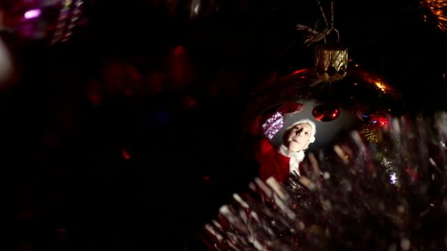 child decorates a Christmas tree video