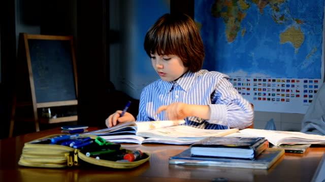 Child doing homework, studying books video