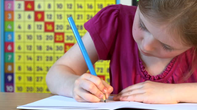 Child doing sums and counting video