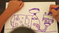 Child drawing a robot video