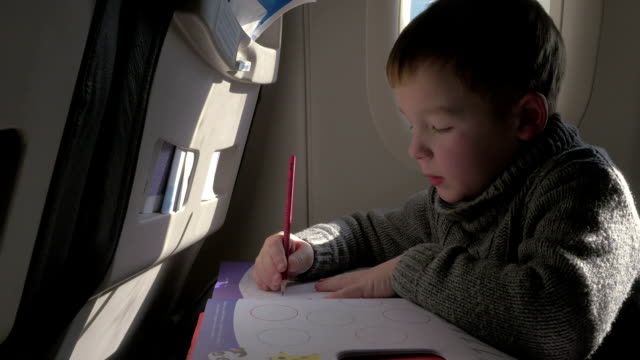 Child drawing during the flight video