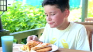 Child eating pizza and french fries video