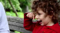 Child eating red currant berries video
