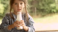 HD-SEQUENCE. Child Enjoying Milk on a Beautiful Summer Morning at The Porch video