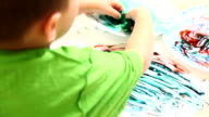 Child finger painting video