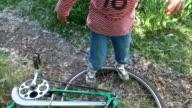 Child girl  check bike for strength. video