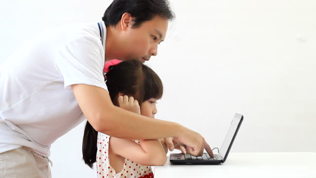 Child girl learning computer. video