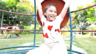 Child girl on play equipment. video