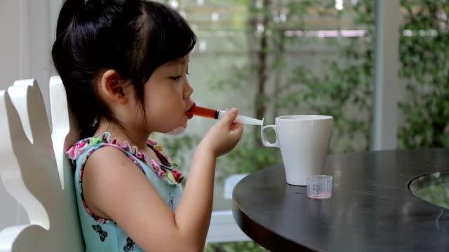 Child, Girl, Taking Medicine Using Syringe video