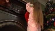 Child hanging Christmas stocking video