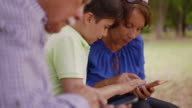 Child Helping Grandma Text Messaging On Mobile Phone video