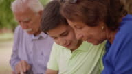 Child Helping Grandparents Going Internet On Phone video