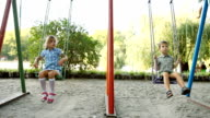 Child in  swing outdoors video