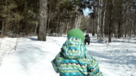 Child is running fast to his family in winter video