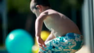 Child jumping into the water at the swimming pool video