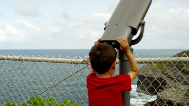 Child looking at nature bird watching video