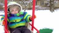 Child on swing in winter video