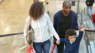 Child On Trip To Shopping Mall With Parents On Escalator video