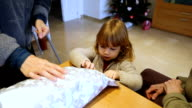 child opening Christmas gift for mother video