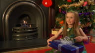 Child opening Christmas gift video