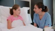 Child Patient In Bed Talking To Doctor In Hospital Room video