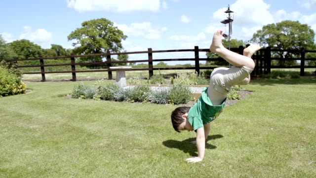 Child Playing Acrobats In the Garden video