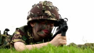 Child playing as an army soldier - with a gun video