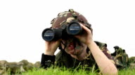 Child playing as an army soldier - with binoculars video
