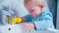 Child playing in bidet video