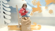 Child Playing in The Christmas Set Design. video