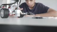 Child playing on Self-made robot STEM video