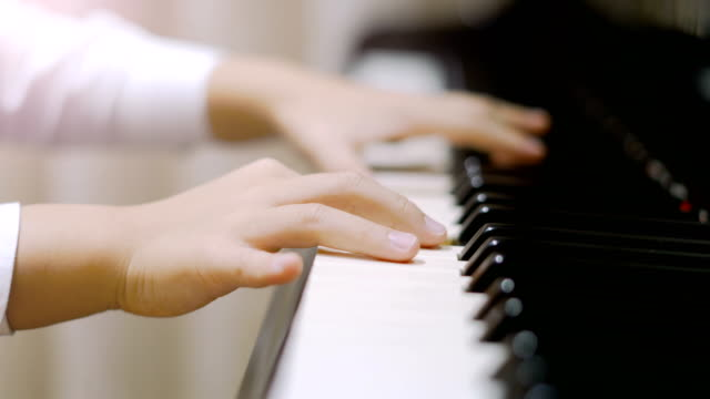 Child playing piano. video