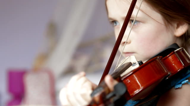 Child playing the violin video