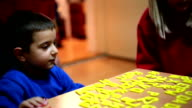 Child playing with Alphabet Letters video