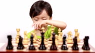 Child playing with chess video