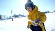 Child playing with icicle in the winter video
